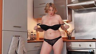 Camilla Creampie's favorite place to masturbate is in her kitchen