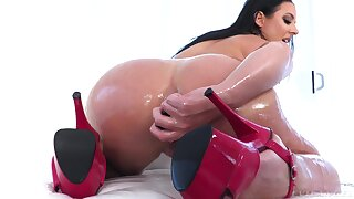 Thick woman pumps her oiled ass with the biggest cock