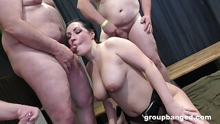 Big boobed bimbo shares her nookie nest with a few studs