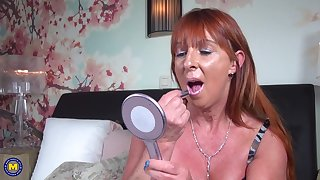 Redhead grown up amateur solo model Saskia M. stuffs her pussy on touching toys