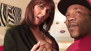 Big-chested MILF's slit gets spread by unrestrained b generally ebony man sausage porn tube
