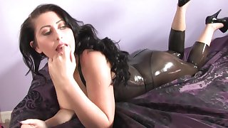 Sophie Star pulls out her boobs from her latex skirt together with squeezes them