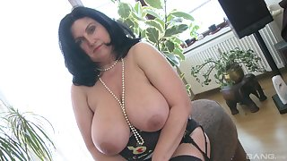 Fat white woman masturbates solo with her glass dildo and moans
