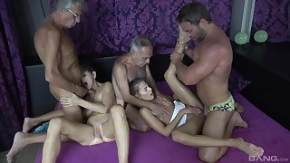 Hot granny craves for these two big dicks in her tiny holes