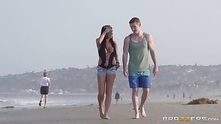 Outdoor fucking on the public beach with delicious Romi Rain