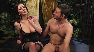 Big-breasted mistress strapon-fucks her slave