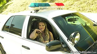 Sitting in cop's car kinky porn actress Cali Carter holds interview